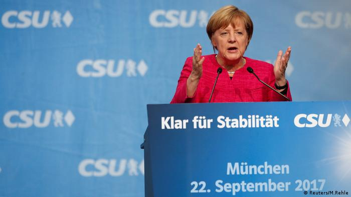 Chancellor Merkel campaigning in Munich two days before the election says she represents stability.