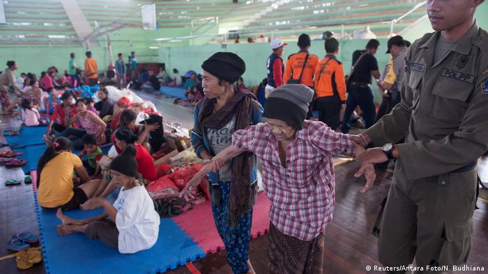 People in Indonesia's Bali in a temporary shelter
