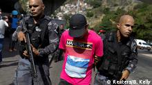 Riot police detain a suspect during an operation after violent clashes between drug gangs in Rocinha slum in Rio de Janeiro, Brazil, September 22, 2017. REUTERS/Bruno Kelly