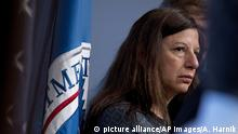 Elaine Duke with a department flag hanging in the background
