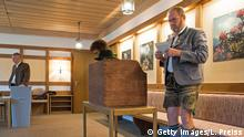 BAYRISCHZELL, GERMANY - SEPTEMBER 24: A man dressed in traditional Bavarian clothes stands next to a voting booth at a polling station during German federal elections on September 24, 2017 in Bayrischzell, Germany. German Chancellor and Christian Democrat (CDU) Angela Merkel is seeking a fourth term and has a strong lead over her rivals in polls taken in days before the election. However, about 20% of voters had said they were undecided, making the final election outcome uncertain. In particular, the right-wing, populist Alternative for Germany (AfD), which had between 10-12% in pre-election polls, has the potential to fair better than polls suggest. (Photo by Lennart Preiss/Getty Images)