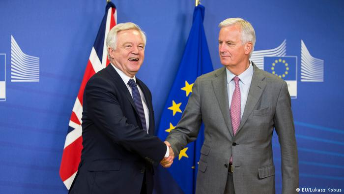 David Davis and Michel Barnier shake hands in Brussels