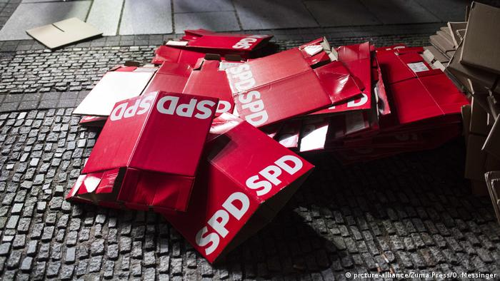 A pile of flattened red cardboard boxes bearing the SPD logo are seen on the ground after a campaign event in Berlin