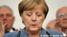 24.09.2017*****BERLIN, GERMANY - SEPTEMBER 24: German Chancellor and Christian Democrat (CDU) Angela Merkel speaks to supporters following initial federal elections results that give the party 33.1% of the vote, giving it a first place finish, though 8.4% less than in the last election four years ago, on September 24, 2017 in Berlin, Germany. Chancellor Merkel is seeking a fourth term and coming weeks will likely be dominated by negotiations between parties over the next coalition government. The right-wing Alterniative for Germany (AfD) finished in the third place with a better-than-expected 13.2%. (Photo by Sean Gallup/Getty Images)