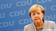Christian Democratic Union CDU party leader and German Chancellor Angela Merkel arrives for a news conference at the CDU party headquarters, the day after the general election (Bundestagswahl) in Berlin, Germany September 25, 2017. REUTERS/Kai Pfaffenbach