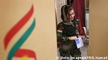 A female member of a Kurdish Peshmerga battalion casts her vote in the Kurdish independence referendum at a polling station in Arbil, on September 25, 2017. Iraqi Kurds voted in an independence referendum in defiance of Baghdad which has warned of measures to defend Iraq's unity and threatened to deprive their region of lifeline oil revenues. / AFP PHOTO / SAFIN HAMED (Photo credit should read SAFIN HAMED/AFP/Getty Images)