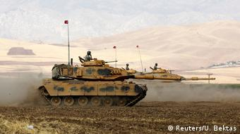 Turkish tanks maneuver during a military exercise near the Turkish-Iraqi border in Silopi