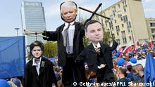 06.05.2017 +++ Demonstrators hold cartoons of leader of PiS (Law and Justice) party Jaroslaw Kaczynski (top), Prime minister Beata Szydlo (L) and President Andrzej Duda (R) during the Freedom March in the Polish capital Warsaw on May 6, 2017 organised by Poland's main liberal Civic Platform (PO) opposition party to protest against the rightwing nationalist Law and Justice (PiS) government over alleged rule of law violations. / AFP PHOTO / Janek SKARZYNSKI (Photo credit should read JANEK SKARZYNSKI/AFP/Getty Images)