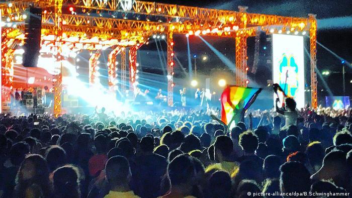Mashrou Leila playing to Cairo crowd, rainbow flag visible