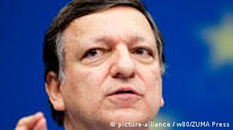 Barroso gestures at a press conference