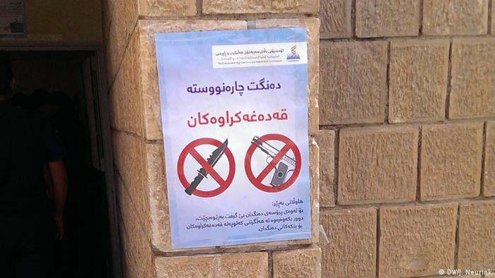 A sign in front of a polling station underlines than weapons are prohibited