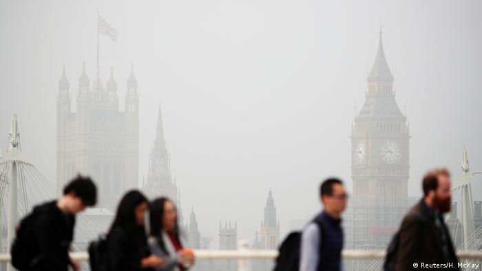 People crossing Waterloo Bridge in London