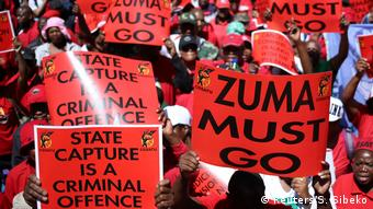 A sea of read posters reading Zuma must go and State capture is a criminal offence