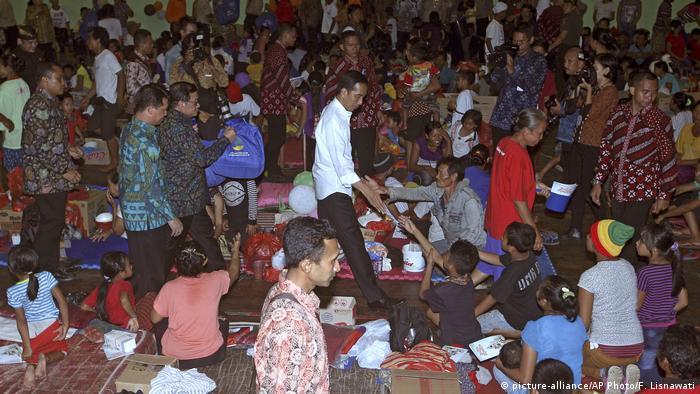 Indonesian President Joko Widodo greets villagers at an evacuation center on the island of Bali