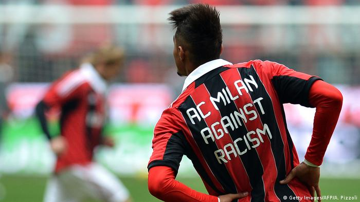 Prince Kevin-Prince Boateng with shirt reading AC Milan against racismGetty Images/AFP/A. Pizzoli)