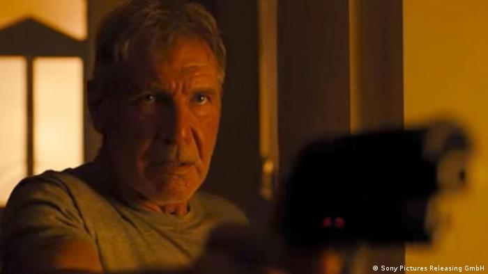 A still from Blade Runner 2049 with Harrison Ford holding a pistol (Sony Pictures Releasing GmbH)