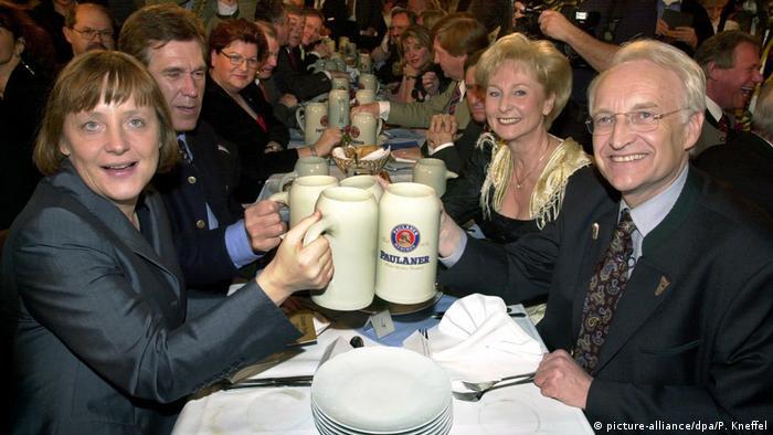 Merkel and Stoiber clink beer steins in 2000