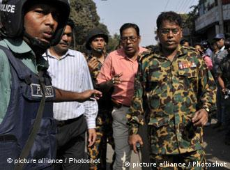 Touhidul Alam (1st R), Deputy Assistant Director of paramilitary Bangladesh Rifles (BDR ) is accused of being the ringleader of a bloody mutiny