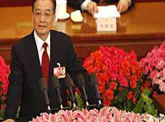 Chinese Premier Wen Jiabao reads his work report during the opening session of National People's Congress in Beijing Thursday, March 5, 2009.