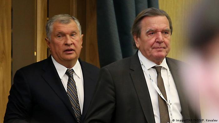 Rosneft oil company CEO and Management Board Chairman Igor Sechin (L) and Gerhard Schroeder