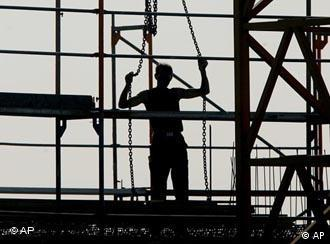 Silhouette of a construction worker on a building site