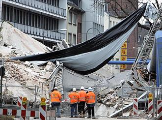 Firefighters at the scene of the collapsed building in downtown Cologne on Wednesday, March 4, 2009.