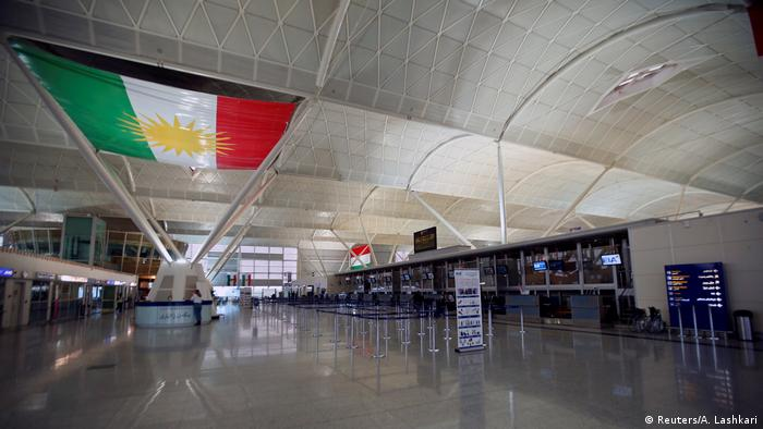 Irbil Airport terminal with a large flag of Kurdistan hung on the ceiling