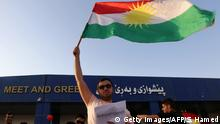 29.09.2017 Iraqi Kurds take part in a demonstration at Arbil airport, in the capital of Iraq's autonomous northern Kurdish region, after the central government ordered the indefinite halt to all foreign flights to and from Iraqi Kurdistan on September 29, 2017. Iraq's government cut the autonomous northern Kurdish region's direct air links with the outside world indefinitely after it voted a massive yes in a referendum on independence. / AFP PHOTO / SAFIN HAMED (Photo credit should read SAFIN HAMED/AFP/Getty Images)
