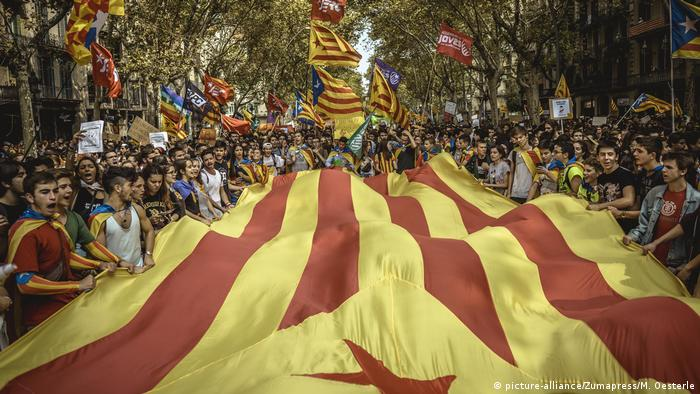 Protesters hold a giant Estelada flag in Barcelona