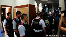 Mossos d'Esquadra, Catalan regional police, enter the Miquel Tarradell high school, one of the designated polling stations, where a group of people assembled to occupy the premises in a bid to allow voting for the banned independence referendum in Barcelona, Spain September 29, 2017. REUTERS/Enrique Calvo
