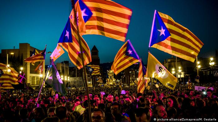 Protesters wave Catalan independence flags in Barcelona