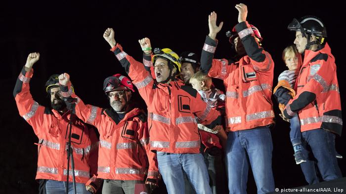 Firefighters raise their fists during a pro-independence protest