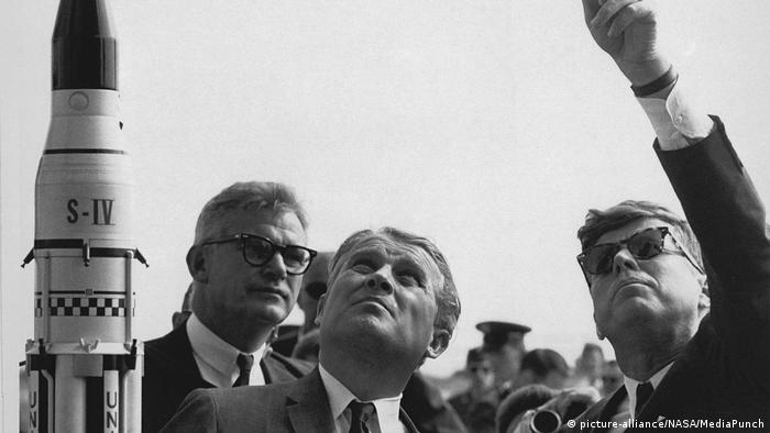 Wernher von Braun explains the Saturn Launch System to United States President John F. Kennedy at Cape Canaveral, Florida