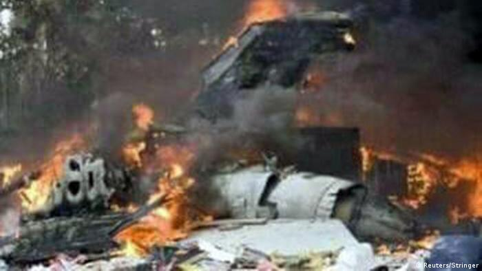 The wreckage of a Russian-made military cargo plane goes up in flames.
