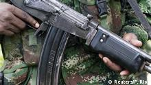 A rebel from Colombia's Marxist National Liberation Army (ELN) shows his weapon in the northwestern jungles, Colombia August 31, 2017. Picture taken August 31, 2017. REUTERS/Federico Rios