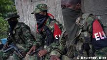 Rebels from Colombia's Marxist National Liberation Army (ELN) take a rest outside a farmer's home, in the northwestern jungles, Colombia August 31, 2017. Picture taken August 31, 2017. REUTERS/Federico Rios