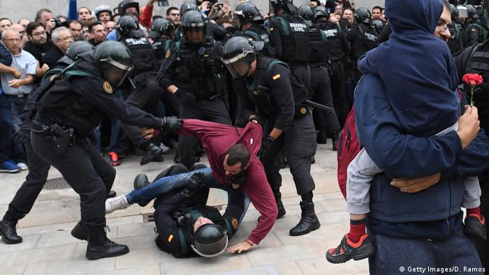 Two police officers drag a protester off another policeman on the ground (Getty Images/D. Ramos)