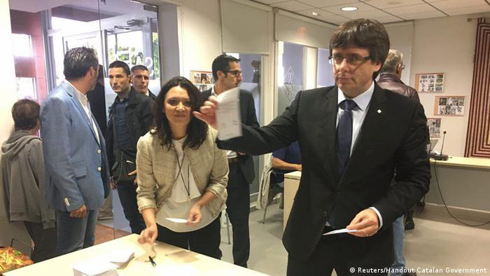 Carles Puigdemont showing his ballot at a polling station (Reuters/Handout Catalan Government)