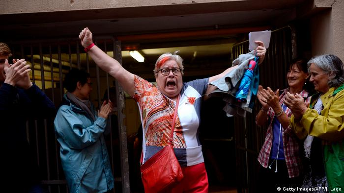 A happy voter celebrates after voting in Barcelona