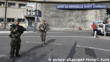 French soldiers patrol outside the Marseille railway station, Sunday, Oct. 1, 2017. French police warn people to avoid Marseille's main train station amid reports of knife attack, assailant shot dead. (AP Photo/Claude Paris)  