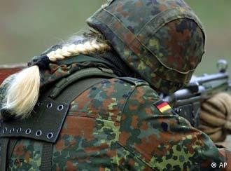 Ponytail and fighting gear -- soon an option for male soldiers