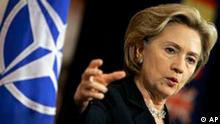 U.S. Secretary of State Hillary Rodham Clinton gestures while speaking during a media conference at a NATO foreign ministers meeting at NATO headquarters in Brussels, Thursday March 5, 2009. Relations with Russia and Afghanistan will be the key items on the agenda. (AP Photo/Virginia Mayo)