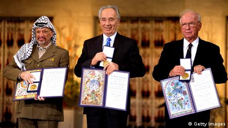 Israeli Prime Minister Yitzak Rabin, Israeli Foreign Minister Shimon Peres and Palestinian leasder Yaser Arafat, the joint Nobel Peace Prize winners for 1994, in Olso, Norway