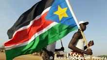 epa02521154 A Southern Sudanese man holds a Southern Sudan flag during the referendum on the independence of South Sudan at a polling station in Juba, Southern Sudan, 09 January 2011. Southern Sudanese went to the polls in a historic referendum that is widely expected to see them vote to split from the north. The week-long vote is the centerpiece of a 2005 peace deal that ended decades of civil war between the mainly Muslim north and the Christian and Animist south - a conflict which claimed the lives of more than 2 million southerners and displaced 4 million more. An emotional Salva Kiir, president of Southern Sudan, choked back tears as he cast his ballot and dedicated the vote to independence leader John Garang - who died in a 2005 helicopter crash - and all those who perished in the war. Just under 4 million Southern Sudanese are registered to put a thumbprint on the ballot - either under a picture of two hands clasping for unity, or one held up as if waving goodbye for secession. Few doubt that jubilant and expectant Southern Sudanese will vote for independence, but at least 60 per cent of registered voters must turn out for the referendum to be valid. The vote, which many had doubted would take place on time, has raised fears of a return to conflict between north and south. EPA/MOHAMED MESSARA +++(c) dpa - Bildfunk+++ |