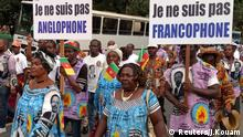 Demonstrators carry banners as they take part in a march voicing their opposition to independence or more autonomy for the Anglophone regions, in Douala, Cameroon October 1, 2017. The banners read: I am not Francophone.(R), I am not Anglophone (L). REUTERS/Joel Kouam
