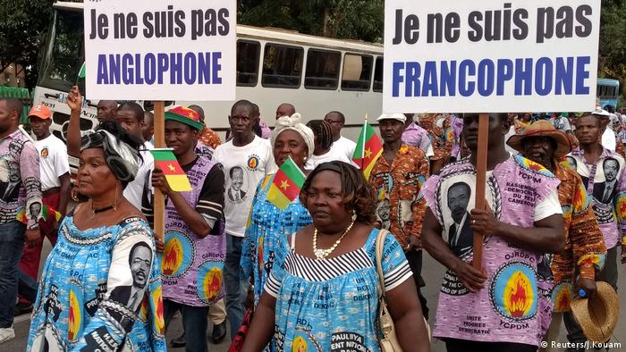 Demonstrators carry banners marching in opposition to independence in Cameroon