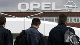 Employees walk into a Opel factory