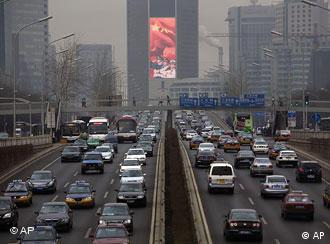 Heavy traffic along a major thoroughfare in Beijing, China, Tuesday, Feb 17, 2009. Beijing's crowded and polluted streets have seen a sharp increase of nearly 66,000 vehicles this year, a 13 percent increase from the previous year, state media reported Tuesday. (AP Photo/Ng Han Guan)