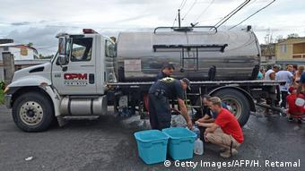 Puerto Rico — getting water from a tank truck (Getty Images/AFP/H. Retamal)