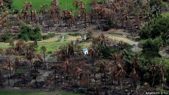 A single structure is left standing in a torched Rohingya village